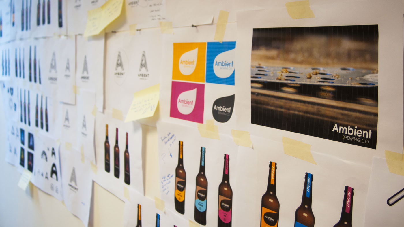 Photograph showing ambient design concepts pinned up on studio wall