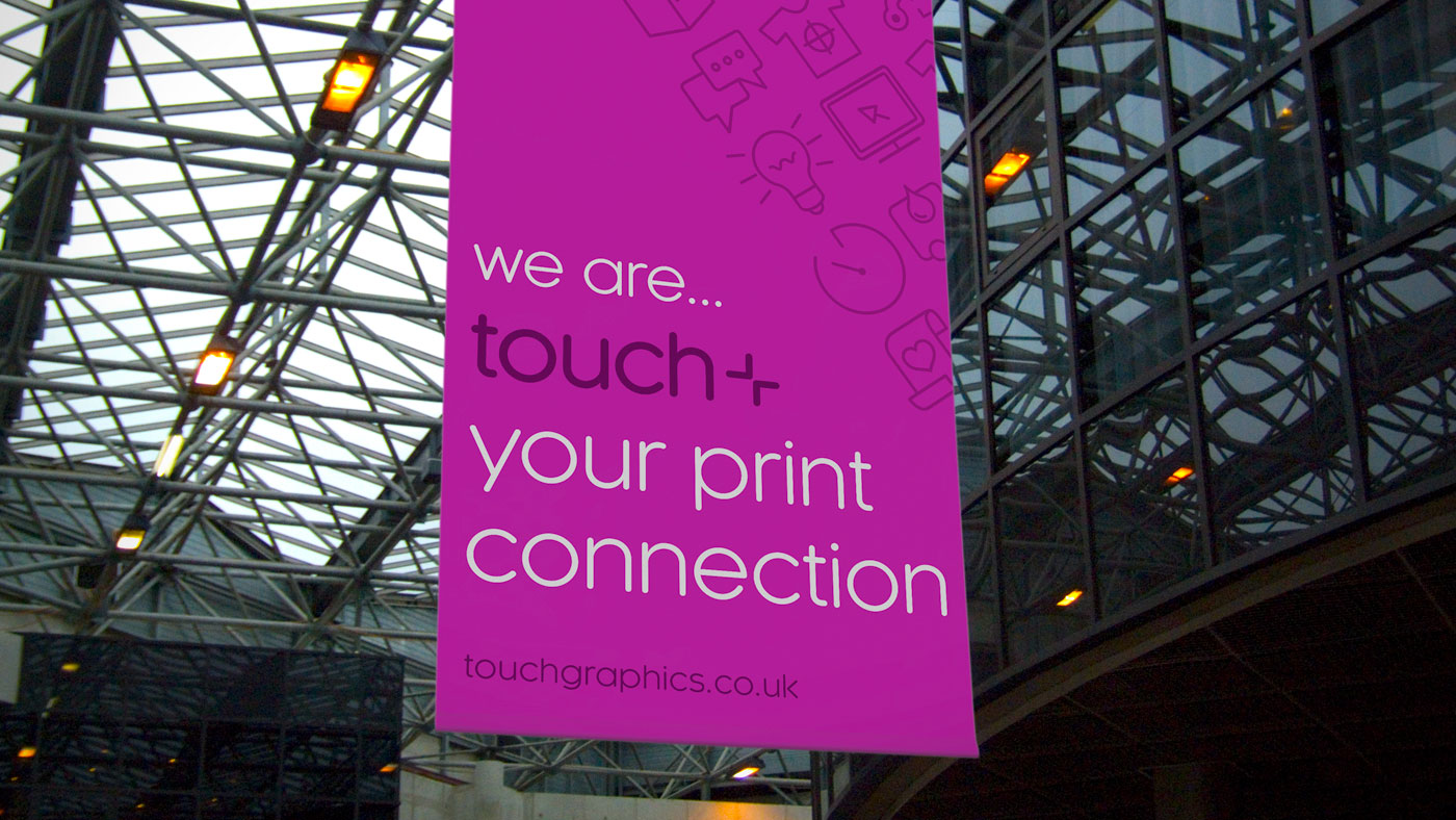 Touch brand applied to large format banner