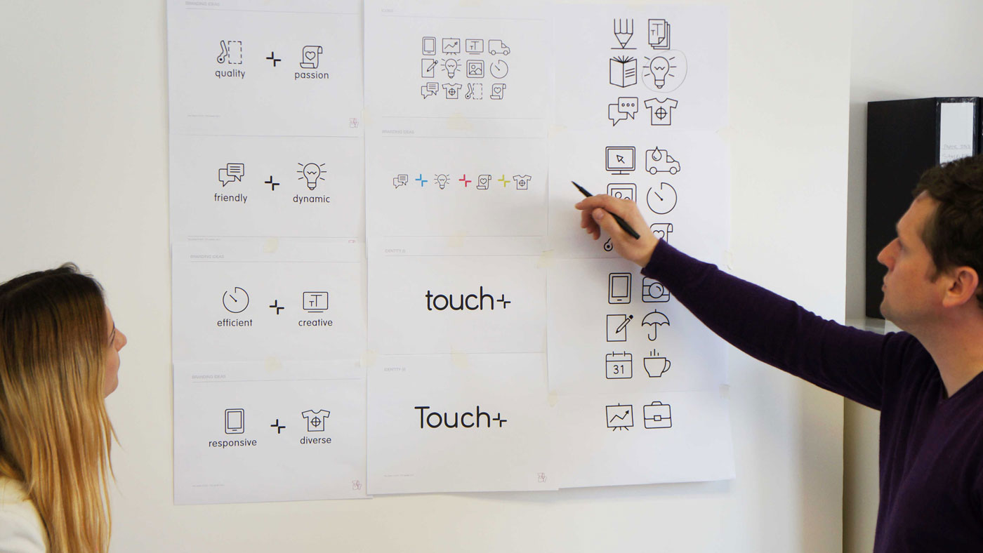 Various Touch concepts pinned on wall in studio