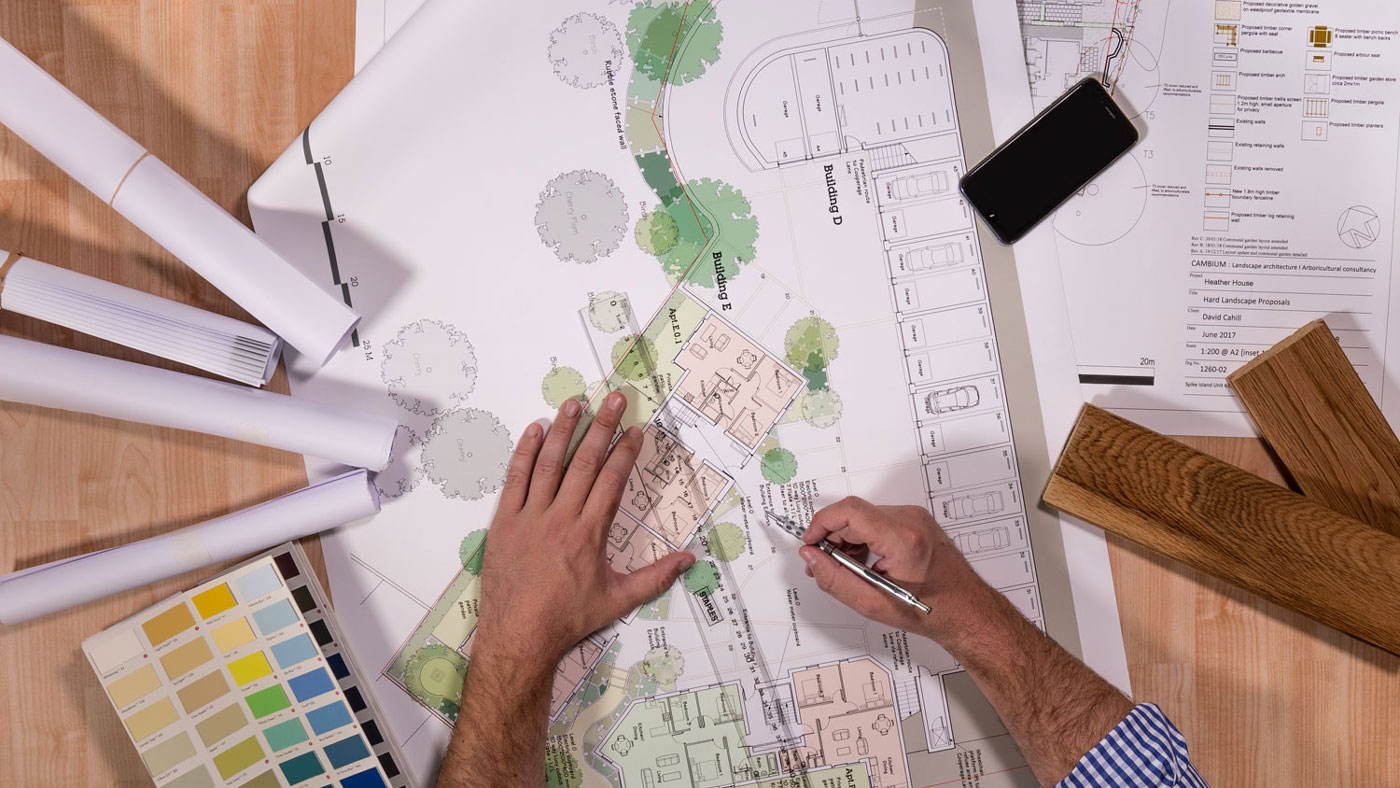 Overhead shot of architects plans on desk