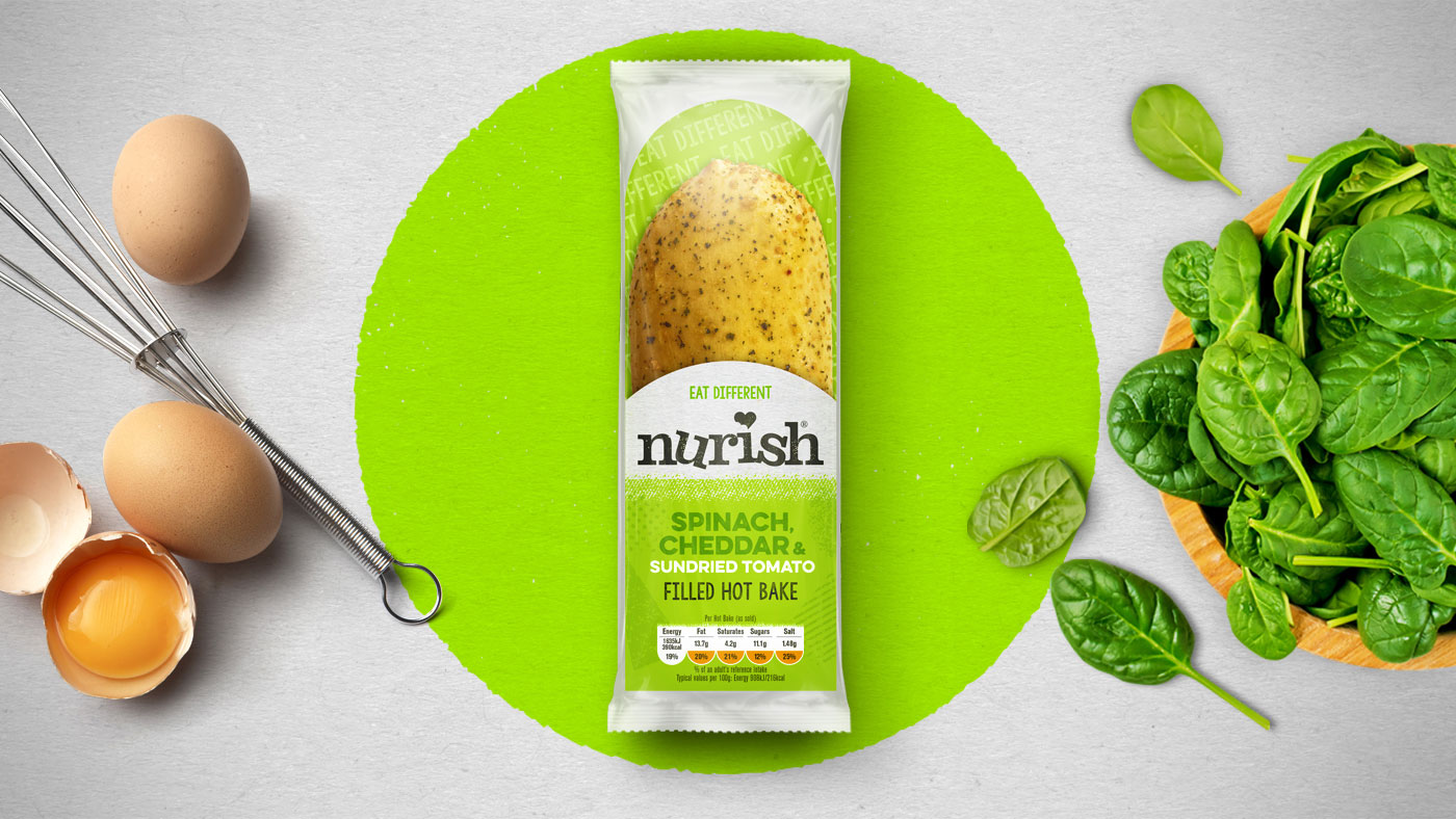 Top down shot of Nurish Spinach, Cheddar & Sun-dried Tomatoes packaging design.